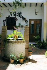 Ronda Home Courtyard (cwgoodroe) Tags: summer costa white hot sol beach del bells spain ancient europe churches sunny bull bullfighter adobe ronda moors walls washed clothesline protective newbridge roda bullring stonebridge oldbridge spainish whitehilltown rondah spanishdoors