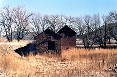 Somewhere Outside Flagstaff 3 (Carrie McGann) Tags: arizona film interesting nikon rust flagstaff oldbuilding