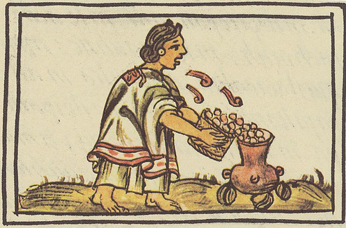 mujer azteca ritual sopla sobre maíz