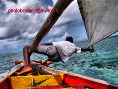 man and sea ...............only for explore (paolo brunetti) Tags: africa sea sky cloud storm man boat barca nuvole mare wind kenya hurricane vessel cielo vela mombasa malindi tempesta uragano