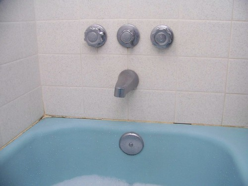 Blue Bathtub And Faucet