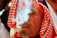A smoking beduin guy - Wadi Rum Jordan (Znapshot.) Tags: travel boy portrait people man black boys face closeup kids female nikon perfect chat photographer market portait awesome femme wadirum arabic adventure cover syria nikkor fabulous markt biketour aleppo becher beduin damaskus syrien arabisch d300 laecheln wueste cloeup goldenglobe altestadt flickrsbest totalphoto passionphotography thecolor anawesomeshot colorphotoaward aplusphoto ultimateshot arabik nikond300 multimegashot adventu marcobecher michaelatischer wwwmarcobecherde znapshot photographybyznapshot