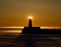 Fire Ice (ImagineGnat) Tags: lighthouse sunrise olympus duluth lakesuperior canalpark