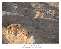 Sunlit Outcropping and Erosion Patterns, Zabriskie Point (G Dan Mitchell) Tags: california morning travel light shadow usa sun texture nature rock point landscape nationalpark earth patterns stock scenic erosion strata deathvalley lit geology zabriskie viewpoint folds stratified outcropping eroded induro
