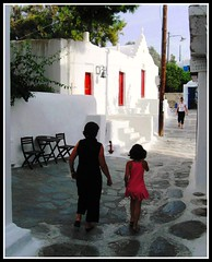 Walking Home in Mykonos, Greece (moonjazz) Tags: life family pink red white history home children island greek child pavement walk tourist greece tradition everyday care simple pure mykonos preservation shareing mywinners