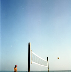 one man game (AAGCTT) Tags: california blue summer sky man 6x6 film mediumformat stranger beachvolleyball orangecounty lagunabeach expiredfilm hasselblad501cm kodakportra100t carlzeissplanar80mmf28cfe