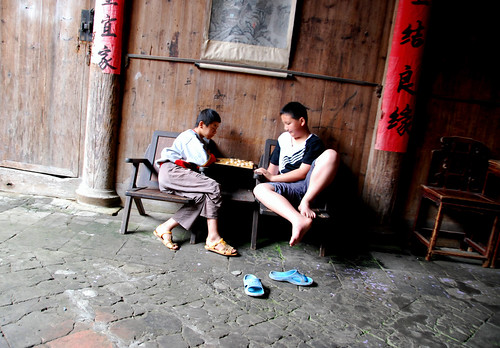 two boys playing chinese chess, xiamei village