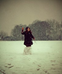 Day 169 - I am a snowgirl (miriness) Tags: portrait england white snow girl hat snowman gloves twigs fallingsnow girlinfield miriness humansnowman