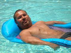706Otter (danimaniacs) Tags: shirtless water pool swimming alone palmsprings raft trunks speedo swimsuit