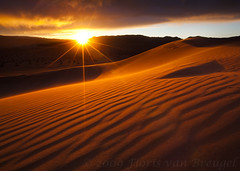 Don't Stare at the Sun (Floris van Breugel) Tags: light sunset sun nature landscape sand bravo desert dunes flare deathvalley ripples soe sunstar anawesomeshot magicdonkeysbest