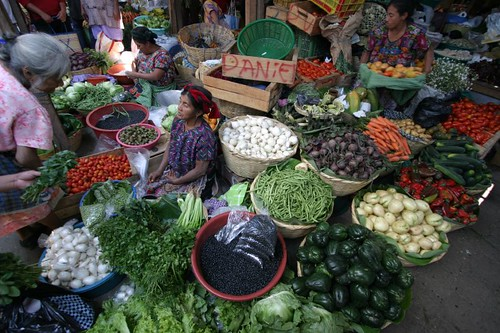 Maya woman surrounded by veggies and fruits...