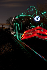Midnight Train Going Nowhere (Chase Hoffman) Tags: bridge light red color green car night train canon eos 50mm nowhere traintracks tracks engine going explore midnight normal cattleguard canonef50mmf14usm lightpaint explored 40d chasehoffman canoneos40d chasehoffmanphotography