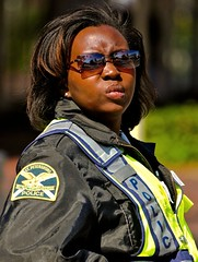 (Lil Wally) Tags: woman girl sunglasses st lady jacket cop pete vest officer lawenforcement womanpolice