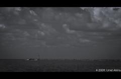 Dia Triste / Sad day (Uriel Akira) Tags: sunset bw lighthouse blancoynegro beach clouds mexico faro atardecer blackwhite sand playa bn arena shore nubes boya veracruz buoy coatza coatzacoalcos nikond40 urielakira