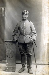 Studio portrait of a soldier from a Train Battalion ( drakegoodman ) Tags: postcard sabre sword worldwarone ww1 greatwar firstworldwar studioportrait cavalry germansoldier feldpost troddel supplytroops