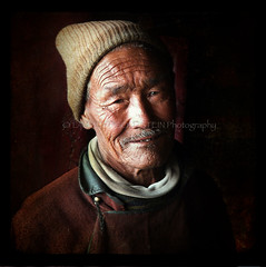 The Gift (designldg) Tags: travel portrait people india man temple emotion expression buddha religion atmosphere monk panasonic human silence soul elder tibetan spiritual shanti chiaroscuro freetibet contrejour ladakh clairobscur  indiasong infinestyle dmcfz18 hourofthesoul