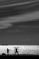 Ship and duo (vonSchnauzer) Tags: ocean street summer blackandwhite beach backlight ship sweden backlit gotland doomsday tanker explored canon5dmii