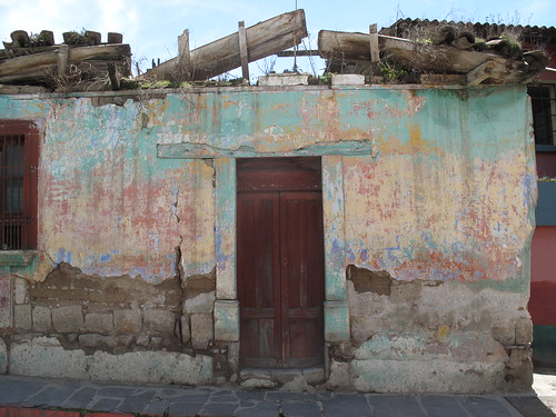 Colourful crumbling building in Xela