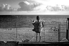 cuc (Donato Buccella / sibemolle) Tags: street sunset sea blackandwhite bw italy beach bike landscape candid liguria streetphotography canon400d sibemolle venustreet shotfromthefasttrain iltrenoandavaa100alloramaforsea50edquasiunmiracolochesiavenuta itreniitalianipermettenoquestecoseconleloroproverbialivelocit fotografiastradale