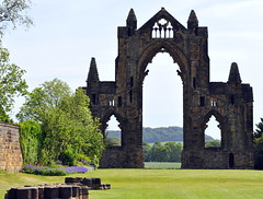 a view beyond the walls (littlestschnauzer) Tags: old uk trees windows summer england green history grass rural countryside ancient nikon ruins worship arch view yorkshire gothic towers north style historical through lush priory guisborough 2011 gisborough d5000