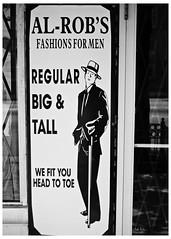 Al-Rob's Fashions For Men (swanksalot) Tags: blackandwhite bw signs chicago fashion 35mm clothing roosevelt faved naturallyblackandwhite swanksalot sethanderson conleyspatch