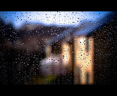 Raining In Suburbia (Komatoes) Tags: blue sky brown house window water glass rain photography 50mm photo droplets nikon bokeh picture explore devon photograph droplet f18 13 raining fp rainwindow d40 rainraingoawaycomeagainanotherday rainonwindow rainonglass nikond40 247bokehlife waitingfor37comments rainhouses