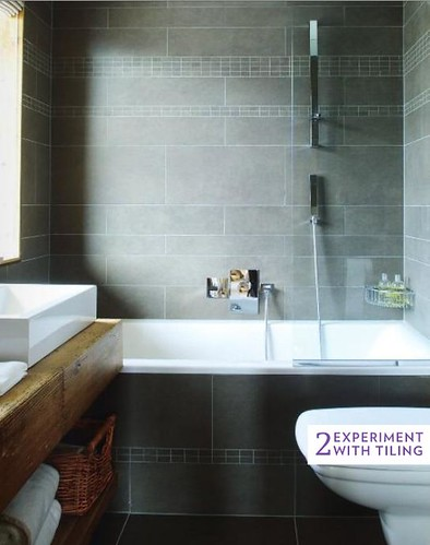 Varying sized tiles in uniform taupe via Living Etc