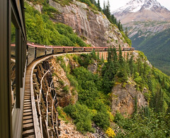 "Scenic Railroad - Skagway, Alaska (IronRodArt - Royce Bair (""Star Shooter"")) Tags: railroad travel trestle bridge white mountains cars tourism alaska train vintage gold wooden track pass scenic railway tourists route skagway yukon rush transportation passenger gauge narrow coaches steep klondike whitepassandyukonroute wpyr"