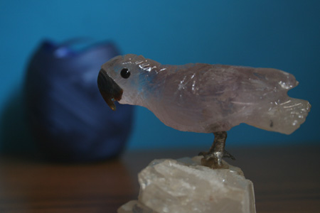 A003 - Purple with brown beak set on crystal