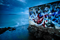 The Wall, Blackrock, Dublin, Ireland (jogorman) Tags: ocean ireland sea howth dublin seascape reflection art wet water pool rain station stone wall night landscape graffiti evening coast twilight nikon paint waves grafitti grafiti dusk tide sigma wave eire spray full explore brine salty pools frame spraypaint nikkor fx 1020mm 1020 tidal dart blackrock dx explored jamesogorman d3x jogorman