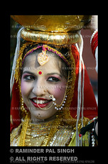 Rajasthan - Colours (Raminder Pal Singh) Tags: portrait woman india color colour girl beauty face lady hair gold golden dance eyes hands artist glow photographer artistic folk teeth joy culture photojournalism makeup lips jewellery clothes 1d beautifulwoman nosering earrings lipstick perform punjab amritsar contrasts bubbly rajasthan bindi beautifulgirl helpinghand compete attire worldculture canon1d indianculture raminder bindiya raminderpalsingh rajasthanigirl lippaint rajasthanfolk flickrlovers earhangings indiatraditional 14thnationalyouthfestival girlwearingrajasthanidress folkdanceperformer rajasthanifolkdancer dressingsense imageofrajasthaniwoman