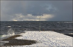 Spring High (North Light) Tags: sea snow coast scotland pier highlands waves harbour tide hoy hightide caithness orkneyislands thursobay springtide thursoharbour