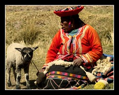 a tribute to womans day (maios) Tags: travel portrait woman pet color alpaca peru southamerica lamp thread america greek photo flickr day photographer south explore handcrafted lama tribute latino fotografia manikis maios iosif heliography        grouptripod    iosifmanikis