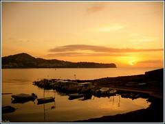 Amanece en Ibiza (Pepe Roselló) Tags: morning sea orange sun sunlight beach sunrise island dawn soleil mar mediterranean mediterraneo alba playa ibiza cielo nubes zodiac eivissa yates tranquilidad talamanca quietwaters mediterranee yate ibizaisland îlle sunriseinibiza amaneceribiza albaenibiza