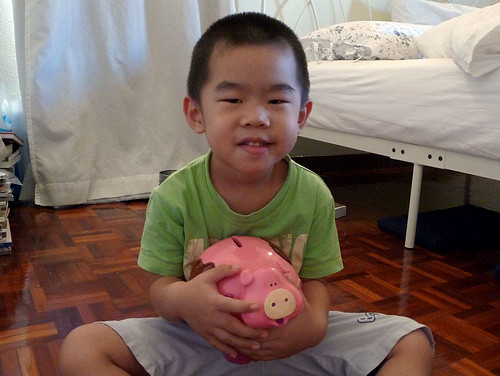 Ryan and his pink piggy bank