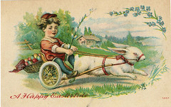 Boy Riding a Rabbit Chariot -Antique Easter Postcard (Ancestors of Cornelius Dunham) Tags: blue boy red hairy house holiday rabbit bunny green stockings hat rural vintage fence easter religious switch happy jumping shoes hare antique farm postcard country religion wheels egg fluffy running racing tires postcards whip eggs colored christianity straps chariot breezy bucolic pascuas reins felicespascuas eastertide   felicespascuas
