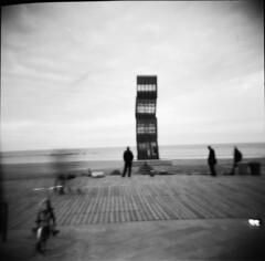 back in 1908 (famar) Tags: barcelona sea copyright film holga lomo lomography mare toycamera barceloneta noedit nophotoshop 120mm scultura holga120cfn famar23 triptospain2009 scannedathomefromnegatvefilm