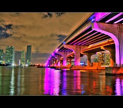 MacArthur Causeway ( Under the Purple bridge ) - Miami (canmom ( Carrie )) Tags: ocean city longexposure bridge sky usa color beach water skyline night clouds reflections sand downtown florida miami miamibeach southbeach hdr biscaynebay yansima downtownmiami macarthurcauseway golddragon theunforgettablepictures theperfectphotographer goldstaraward