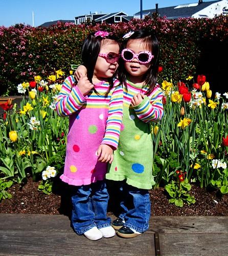 Sweet little girls fit right in with those pretty flowers