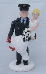 Fimo Groom and Bride in Arms Wedding Cake Toppers (pauline@weddingtreasures) Tags: flowers wedding cake groom bride weddingcake fimo figurines sculpey redshoes toppers polymer