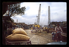 Construction - IN 1987 Carousel2-007 (Eric.Parker) Tags: india car bike bicycle construction crane 1987 taxi africanamerican kolkata bengal calcutta westbengal
