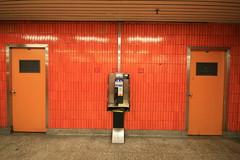 St Clair Subway Station, Toronto (Tony Lea) Tags: b 2 orange 6 3 public station st canon subway tile lens rebel 1 phone angle y 5 ttc c telephone 4 wide 7 8 9 sigma wideangle x tony payphone tiles pay u transit lea anthony z mm 1020mm 1020 clair xti tonylea thisimagemaynotbeusedinanywaywithoutpriorpermissionallrightsreserved2009 anthonylea