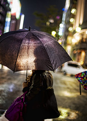 In the Rain in Tokyo (Stuck in Customs) Tags: world city travel light people building wet japan night umbrella lens photography tokyo blog high asia dynamic stuck bokeh candid godzilla purse photograph parasol april reflective translucent  prefecture range hdr trey travelblog customs 2010  intherain tky ratcliff tkyto hdrtutorial stuckincustoms treyratcliff  photographyblog stuckincustomscom nikond3s nijsanku  tokubetsuku