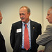 Bob Miller of Pentair Water Pool and Spa, Inc. (left) talks with Itron's Ed White (center) and Jim Trainham of Research Triangle Solar Fuels Institute (r).