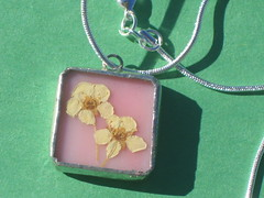 pink pendant with yellow flowers