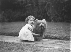 Study of a small girl with a prize Scottish terrier dog, c. 1935 / by Sam Hood (State Library of New South Wales collection) Tags: girl dog fluffy child hug animal cute niña pequeña perro vestido ropa abrazo cariño samhood terrier footpath lawn garden friendship bond friends news vintage statelibraryofnewsouthwales toddler brickpath portrait bw snapshot pet posing canine cuddle pretty cairnterrier grass pavement fur commons:event=commonground2009 mädchen hund sweet thelittledoglaughed blackwhite black white blackandwhite bandw dc:creator=httpnlagovaunlaparty587349 xmlns:dc=httppurlorgdcelements11 captivating adorable this is beautiful photo by sam hood i love its simplicity mammal canis kid scottishterrier dress locks