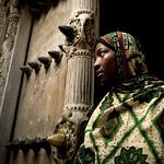 Miss Latifa in front of Zanzibar old door, Tanzania