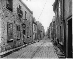 Little Champlain Street, Quebec City, QC, 1916 (Muse McCord Museum) Tags: poverty street houses homes irish canada wooden quebec path timber montreal perspective shutters quebeccity qc 1916 diele fantastik mccordmuseum irlandais musemccord dielenboden littlechamplainstreet timberpavement commons:event=commonground2009 vrement