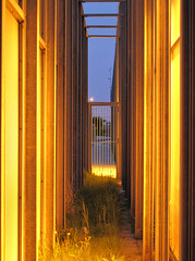 Narrow alley lights. (Harry -[ The Travel ]- Marmot) Tags: park door blue sky orange abstract holland netherlands strange grass amsterdam architecture modern fence lights evening licht alley iron steel nederland science narrow steegje deur hek oost sciencepark watergraafsmeer steeg staal ornaje