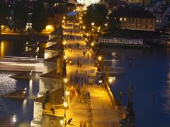 Charles Bridge, Prague (Neil_Clarke) Tags: longexposure bridge people blur reflection tower water night river lights boat movement view czech prague tide statues charlesbridge vltava karluvmost
